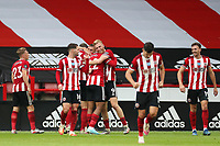 Football - 2019 / 2020 Premier League - Sheffield United vs Tottenham Hotspur<br /> Oliver McBurnie of Sheffield United celebrates scoring his sides third goal to make the score 3-1, at Bramall Lane.<br /> <br /> COLORSPORT/PAUL GREENWOOD