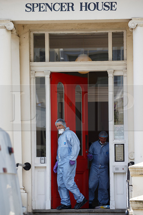 © Licensed to London News Pictures. 01/07/2014. LONDON, UK. Forensics officers investigating a murder scene where an elderly man has been stabbed to death in Belsize Park, Camden. The victim, believed to be in his 60s, was found dead at a sheltered accommodation. Photo credit : Tolga Akmen/LNP