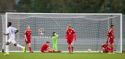 NEWPORT, WALES - Thursday, September 25, 2014: Wales players look dejected as France score the opening goal during the Under-16's International Friendly match at Dragon Park. (Pic by David Rawcliffe/Propaganda)