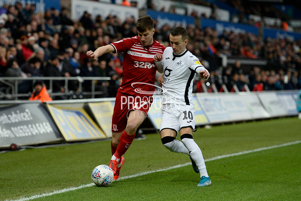 Paddy McNair (17) of Middlesbrough battles for possession with Bersant Celina (10) of Swansea City during the EFL Sky Bet Championship match between Swansea City and Middlesbrough at the Liberty Stadium, Swansea, Wales on 14 December 2019.