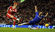 Liverpool's Spanish forward Fernando Torres (L) shoots past Chelsea's Brazilian defender Alex during the Premier league football match at Anfield, Liverpool, north-west England, on February 1, 2009.