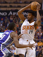 Mar 15, 2017; Phoenix, AZ, USA; Phoenix Suns guard Ronnie Price (14) handles the ball against Sacramento Kings guard Langston Galloway (9) in the first half at Talking Stick Resort Arena. Mandatory Credit: Jennifer Stewart-USA TODAY Sports