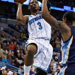 January 19, 2011; New Orleans, LA, USA; New Orleans Hornets point guard Chris Paul (3) shoots over Memphis Grizzlies point guard Mike Conley (11)  during the third quarter at the New Orleans Arena. The Hornets defeated the Grizzlies 130-102 in overtime.  Mandatory Credit: Derick E. Hingle