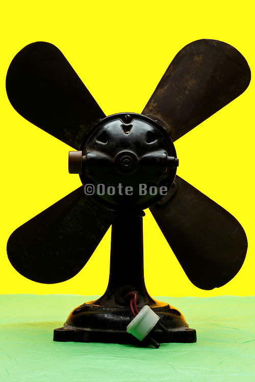 antique fan object on yellow green background