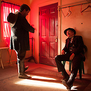 Actors take a break backstage between re-enactments of the infamous gunfight at the OK Corral in Tombstone, Arizona. Actor group leader/director, Tim Fattig (left, in character as Frank McLaury) chats with James Robert (right, in character as Morgan Earp).