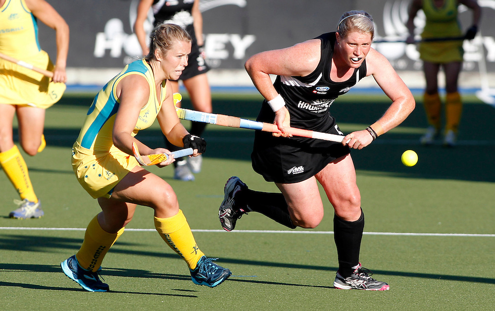 Australia's Jade Warrender, left and New Zealand's Katie Glynn compete for the ball during their four nations hockey match at Lloyd Elsmore Hockey Stadium, Auckland, New Zealand, Wednesday, April 18, 2012. Credit:SNPA / Ben Campbell..