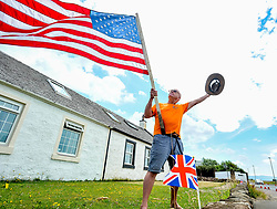 Pictured: Trump supporter and Turnberry resident Bill McGibbon shows his support for the controversial President.<br /> <br /> Protesters gathered amid tight security at the Trump Turnberry resort, where President Trump and his wife Melania are staying on their trip to Scotland.<br /> <br /> &copy; Dave Johnston / EEm