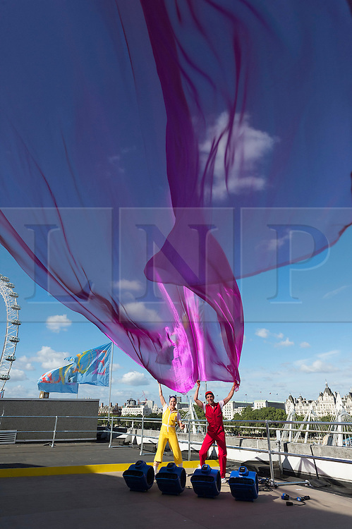 © Licensed to London News Pictures. 08/08/2016. Performance artists CHRISTINA GELSONE and SETH BLOOM AND of ACROBUFFOS present Airplay at  part of The Festival Of Love at Southbank Center, UK. Photo credit: Ray Tang/LNP