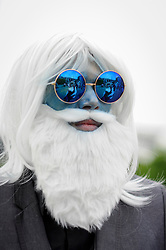 © Licensed to London News Pictures. 28/05/2017. London, UK. A man dressed as Ice King from Adventure Time at MCM Comic Con taking place at Excel in East London.  The three day event celebrates popular comic books, anime, games, television and movies.  Many attendees take the opportunity to dress as their favourite characters.    Photo credit : Stephen Chung/LNP