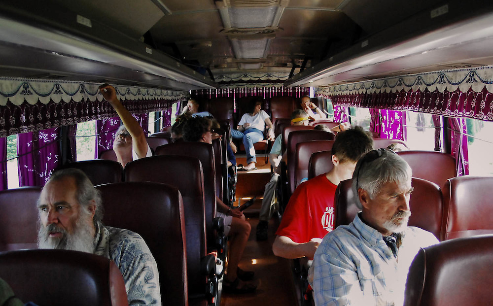 The journey to Vietnam included daily domestic travel by planes, trains and air-conditioned coach.  The bus was a place to gather one's thoughts, drink water, and cool off between adventures.  The back of the bus is where people would retreat for comic relief.  (Laura FongTorchia/Special to the Akron Beacon Journal)