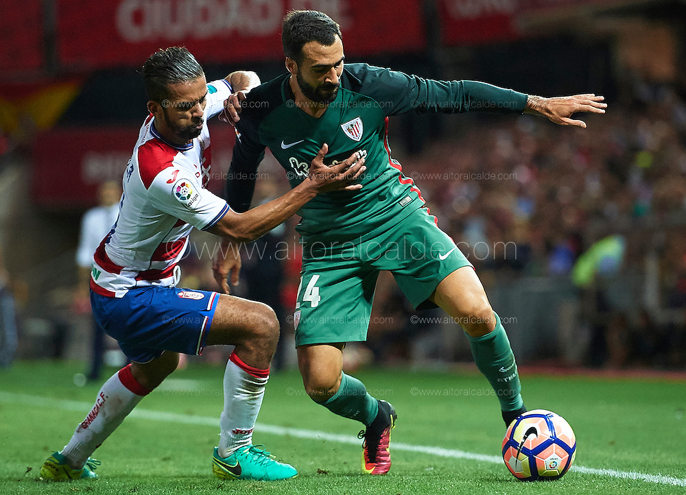 GRANADA, SPAIN - SEPTEMBER 21:   Mehdi Carcela-Gonzalez of Granada CF (L) competes for the ball with Mikel Balenziaga of Athletic Club (R) during the match between Granada CF vs SD Eibar as part of La Liga at Nuevo los Carmenes Stadium on September 11 on September 21, 2016 in Granada, Spain.  (Photo by Aitor Alcalde Colomer/Getty Images)