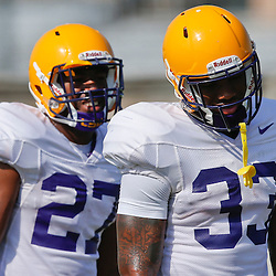 Aug 8, 2013; Baton Rouge, LA, USA; LSU Tigers running back Jeremy Hill (33) and running back Kenny Hilliard (27) during a fall practice at the McClendon Practice Facility. Mandatory Credit: Derick E. Hingle-USA TODAY Sports