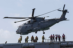 Prince Charles departs in a helicopter from HMS Illustrious during his and Camilla's visit to Portsmouth, United Kingdom. Wednesday, 26th February 2014. Picture by i-Images