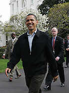 President Obama walks to the basketball courst at the White House Easter Egg Roll on the South Lawn of the White House on April 13, 2009.  Photograph by Dennis Brack