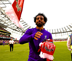DUBLIN, REPUBLIC OF IRELAND - Saturday, August 4, 2018: Liverpool's Mohamed Salah gives scarves to the supporters after the preseason friendly match between SSC Napoli and Liverpool FC at Landsdowne Road. (Pic by David Rawcliffe/Propaganda)