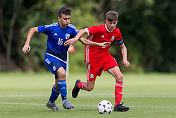 WREXHAM, WALES - Tuesday, August 13, 2019: Cyprus' Michael Chiromerides and Wales' captain Ben Lloyd during the UEFA Under-15's Development Tournament match between Wales and Cyprus at Colliers Park. (Pic by Paul Greenwood/Propaganda)