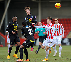 Cheltenham Town's Zack Kotwica challenges for the ball against  Bury's Danny Rose- Photo mandatory by-line: Nizaam Jones - Mobile: 07966 386802 - 14/02/2015 - SPORT - Football - Cheltenham - Whaddon Road - Cheltenham Town v Bury - Sky Bet League Two