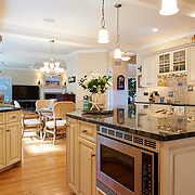 LONG BEACH, NJ - SEPTEMBER 16, 2016: The first floor kitchen has deeply marbled granite countertops and a Dacor range with matching oven and under-island microwave. Wet bar with matching counters and cabinets is next to the fridge. 6 E. 34 Street, Long Beach, NJ. Credit: Albert Yee for The New York Times