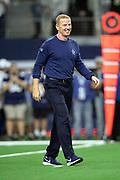 Dallas Cowboys head coach Jason Garrett has a laugh during pregame warmups before the NFL week 13 regular season football game against the New Orleans Saints on Thursday, Nov. 29, 2018 in Arlington, Tex. The Cowboys won the game 13-10. (©Paul Anthony Spinelli)