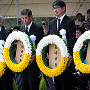 NAGASAKI, JAPAN - AUGUST 9 : Mayor of Nagasaki, representatives of bereaved families and representatives of Atomic bomb survivors lays wreath for the atomic bomb victims in front of the Peace Statue in Nagasaki Peace Park, Nagasaki, southern Japan, Tuesday, August 9, 2016. Japan marked the 71st anniversary of the atomic bombing on Nagasaki. On August 9, 1945, during World War II, the United States dropped the second Atomic bomb on Nagasaki city, killing an estimated 40,000 people which ended World War II. (Photo by Richard Atrero de Guzman/NURPhoto)