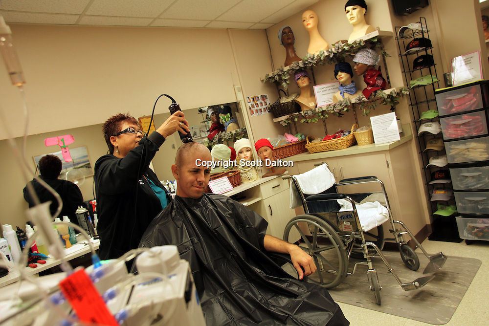Luis Elizondo, 29, gets his head shaved at the barbershop at the MD Anderson Cancer Center in Houston, TX on October 5, 2009. Mr. Elizondo has lost most of his hair due to treatments to combat his leukemia at the hospital. (Photo/Scott Dalton)