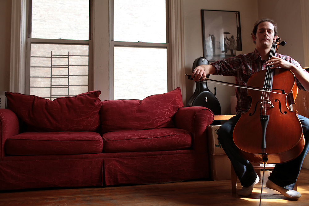 Musician Mike Block plays cello in his apartment in Manhattan, New York on May 01, 2011. The Julliard-trained cellist and composer is bringing a new performance series GALA/NYC to the Brooklyn Lyceum in Park Slope..CREDIT: Melanie Burford/Prime for The Wall Street Journal..Slug: NYMIKEBLOCK