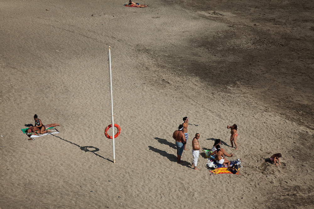 People on the beach in Costa Adeje, South Tenerife.