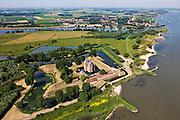 Nederland, Gelderland, Gemeente Zaltbommel, Poederoijen, 08-07-2010; Slot Loevestein, kasteel, strategisch gelegen op de plaats waar Waal en Maas in het verleden samenkwamen. De Maas is nu de Afgedamde Maas, boven in beeld met vesting Woudrichem. Loevestein maakt deel uit van de Hollandse Waterlinie..Loevestein, castle, strategically located at the place where Waal and Meuse in the past came together. Loevestein is part of the Holland Waterline (defense line)..luchtfoto (toeslag), aerial photo (additional fee required).foto/photo Siebe Swart.