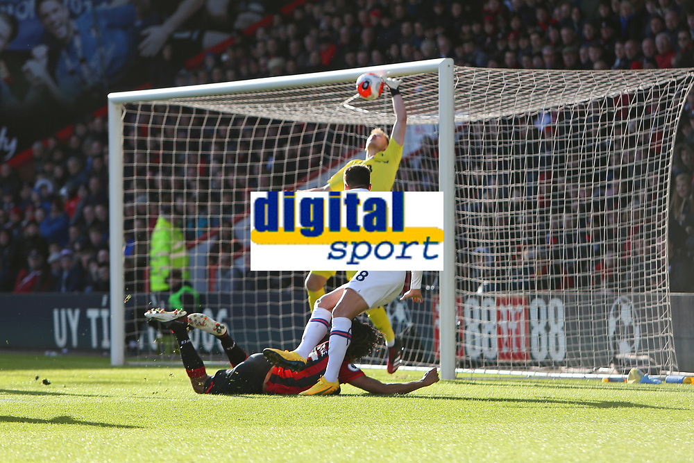 Football - 2019 / 2020 Premier League - AFC Bournemouth vs. Chelsea<br /> <br /> Olivier Giroud of Chelsea flicks the ball goal wards infront of Bournemouth's Nathan Ake head only for the ball to hit the crossbar during the Premier League match at the Vitality Stadium (Dean Court) Bournemouth  <br /> <br /> COLORSPORT/SHAUN BOGGUST