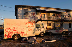 21 December 05. New Orleans, Louisiana. Post Katrina aftermath.<br /> Rescue workers graffiti lingers on trucks, cars and walls of the devastated 9th Ward long after the devastating flood from Hurricane Katrina subsided. <br /> Photo; ©Charlie Varley/varleypix.com