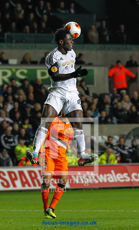 Picture by Mike  Griffiths/Focus Images Ltd +44 7766 223933<br /> 28/11/2013<br /> Wilfried Bony of Swansea City and Victor Ruiz of Valencia Club de F&uacute;tbol during the UEFA Europa League match at the Liberty Stadium, Swansea.