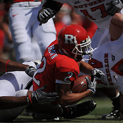 Apr 18, 2009; Piscataway, NJ, USA; Rutgers WR Tim Brown (2) is gang tackled by the entire starting linebacker corps for the White team during the first half of Rutgers' Scarlet and White spring football scrimmage.