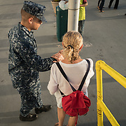WEDNESDAY, OCTOBER 4- 2017--- - SAN JUAN, PUERTO RICO - <br /> Aida Pagan, 59 from San Juan, gets help as she  steps off  the US Naval Hospital Ship Comfort at the Port of San Juan where it started treating patients affected by Hurricane Maria.<br /> (Photo by Angel Valentin for NPR)