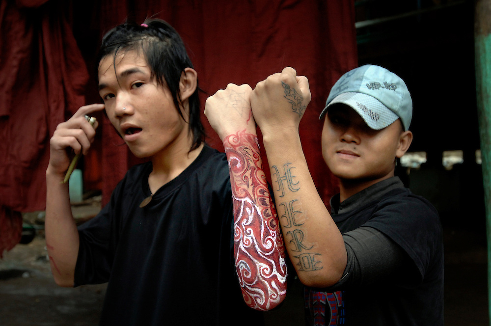 Mae La refugee camp,  Thailand (Thai-Burma border)<br /> 05 October  2007<br /> <br /> Tatu (left) and Soyu (right), two Karen refugees, show their tattoos to the photographer.<br /> Burmese political refugees, from the main ethnic Karen, have been living for more than 20 years in this camp, at approximately 80km of Mae Sot. The refugees are mainly Buddhists and Christians, with a smaller number of Muslims. Mae La's refugee camp counts approximately 50.000 refugees.<br /> Photo: Ezequiel Scagnetti