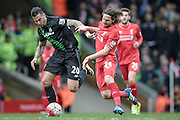 Joe Allen (Liverpool) and Geoff Cameron (Stoke City) fight to get to the ball during the Barclays Premier League match between Liverpool and Stoke City at Anfield, Liverpool, England on 10 April 2016. Photo by Mark P Doherty.