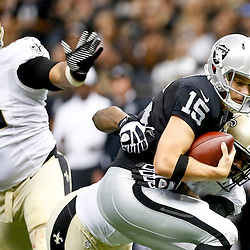 Aug 16, 2013; New Orleans, LA, USA; New Orleans Saints defensive end Cameron Jordan (94) sacks Oakland Raiders quarterback Matt Flynn (15) during the first quarter of a preseason game at the Mercedes-Benz Superdome. Mandatory Credit: Derick E. Hingle-USA TODAY Sports