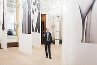 "FLORENCE, ITALY - 29 JUNE 2016: The new director of the Uffizi Gallery Eike Schmidt introduces and explains the photography exhibition ""Karl Lagerfeld – Visions of Fashion"", hosted by Palazzo Pitti, to the museum guards in Florence, Italy, on June 29th 2016.<br /> <br /> Art historian Eike Schmidt, former curator and head of the Department of Sculpture, Applied Art and Textiles at the Minneapolis Institute of Arts, became the first non-Italian director of the Uffizi in August 2015, replacing Antonio Natali who directed the gallery for 9 years. One of the main goals of the new director is to open the Vasari Corridor to the general public. Currently the corridor can only be visited with group reservations made by external tour and travel agencies throughout the year.<br /> <br /> The Vasari Corridor is is a 1-kilometer-long (more than half mile) elevated enclosed passageway which connects the Palazzo Vecchio with the Palazzo Pitti, passing through the Uffizi Gallery and crossing the Ponte Vecchio above the Arno River, in Florence. The passageway was designed and built in 1564 by Giorgio Vasari in only 6 months to allow Cosimo de' Medici and other Florentine elite to walk safely through the city, from the seat of power in Palazzo Vecchio to their private residence, Palazzo Pitti. The passageway contains over 1000 paintings, dating from the 17th and 18th centuries, including the largest and very important collection of self-portraits by some of the most famous masters of painting from the 16th to the 20th century, including Filippo Lippi, Rembrandt, Velazquez, Delacroix and Ensor."