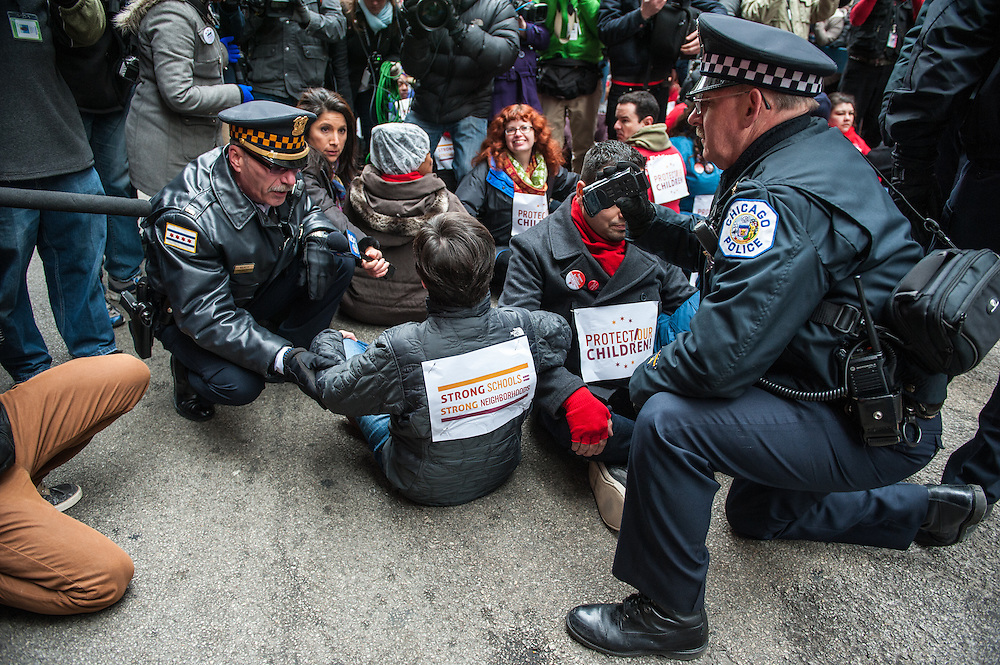 The Chicago Police Department arrest protestors opposing the closing of 53 Chicago public schools.