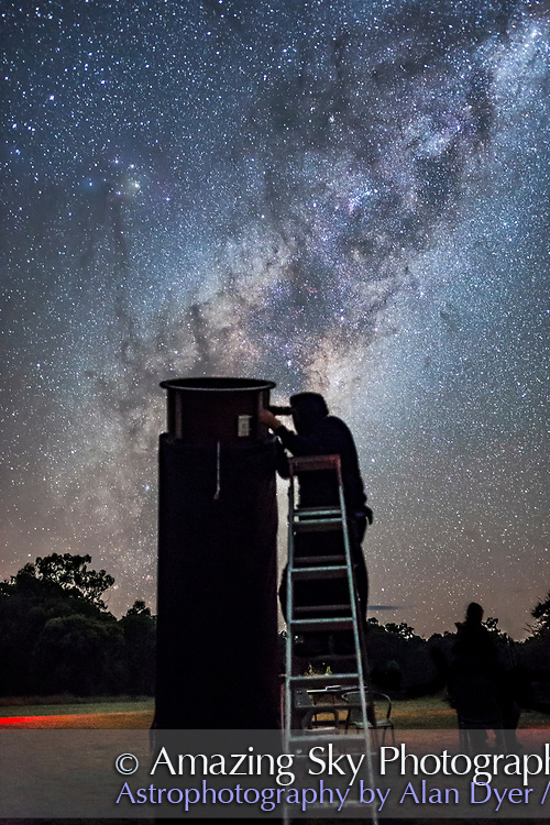 An observer at the 2017 OzSky Star Party peers into the southern sky with the Milky Way galactic centre rising behind him and as a bright backdrop. At the Warrumbungles Motel site in Australia.