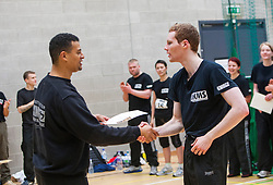 A P1 student receives his pass certificate from Franklyn Hartkamp at the Institute Of Krav Maga Scotland grading today at Stirling.<br /> &copy;Michael Schofield.