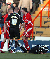 Photo: Ed Godden.<br />Bristol City v Swansea. Coca Cola League 1. 28/01/2006.<br />Swansea's Tom Williams (ground), lies injured as Lee Trundle tries to calm down the Bristol players.