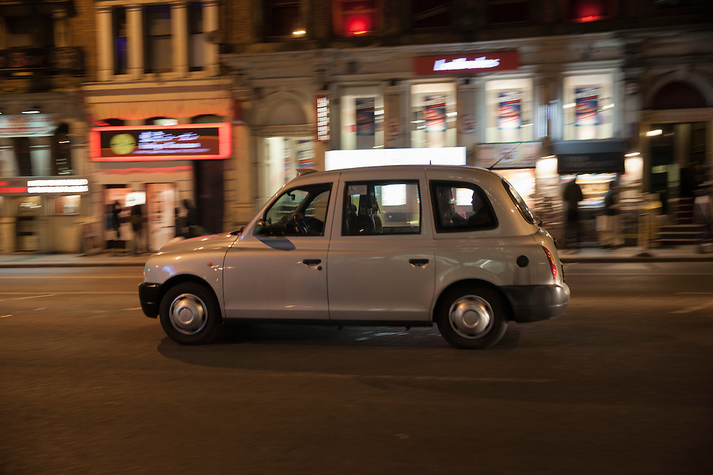 Taxi cruising through the streets of Manchester, UK.