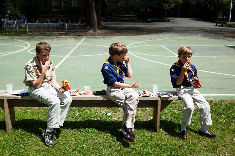 William Anderson, left, 12, and his twin brothers Rhys and Noah Anderson, both 8, eat at Norwich Green after the Memorial Day Parade in Norwich, Vt., on May 25, 2014. (Valley News - Will Parson)