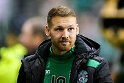Martin Boyle (#10) of Hibernian takes his place on the bench ahead of the Ladbrokes Scottish Premiership match between Hibernian and Rangers at Easter Road, Edinburgh, Scotland on 19 December 2018.