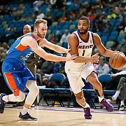 Reno Bighorns Guard AARON HARRISON (1) drives against Oklahoma City Blue Guard BRYCE ALFORD (20) during the NBA G-League Basketball game between the Reno Bighorns and the Oklahoma City Blue at the Reno Events Center in Reno, Nevada.
