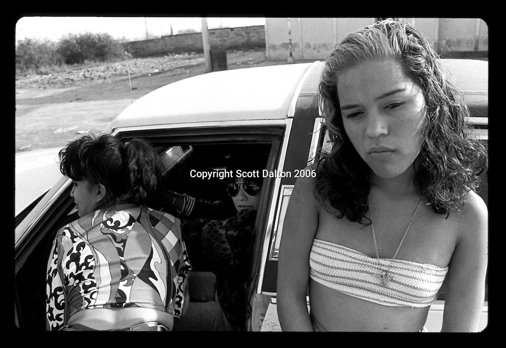 Prostitutes on the streets of Boystown, in Nuevo Laredo Mexico, just across the US-Mexico border from Laredo, Texas. Boystown is a walled community, only one way in or out, which is home to the cities prostitution and red light bars. Many of the prostitutes who work there are transsexuals and transvestites. The idea behind the walled community is to isolate the activities associated with red light districts. (Photo/Scott Dalton)