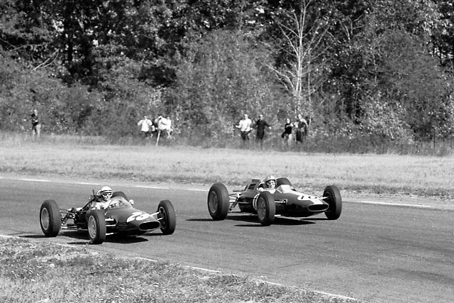 "Phil Hill (ATS 25) and Pedro Rodriguez (Lotus 10) in the ""Loop Chute"" bend at the far end of Watkins Glen."
