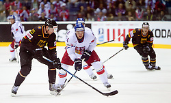 Marcel Muller of Germany vs Karel Rachunek  of Czech republic during ice-hockey match between Germany and Czech republic of Group E in Qualifying Round of IIHF 2011 World Championship Slovakia, on May 9, 2011 in Orange Arena, Bratislava, Slovakia.  (Photo By Vid Ponikvar / Sportida.com)