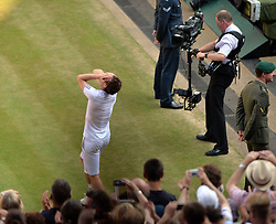 © London News Pictures. 07/07/2013 . London, UK. Andy Murray celebrates after his men's singles final victory over Novak Djokovic of Serbia at the Wimbledon Lawn Tennis Championships final, becoming the first British male to win the tournament in 77 years. Photo credit: Mike King/LNP