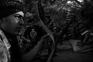 Libyan rebel fighters on the watch at a frontline near Al Dafniyah, 25 km west of Misrata.  30 May 2011.